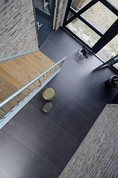 like the contrast of wood and dark basalt neolith floor. Perhaps use small entryway slabs incorporated in wood floor. click now for more info. Neolith Stone, Stone Flooring, Flooring Ideas, Dark Flooring, Ceramic Flooring, Floors, Buy Tile, Wood Stairs, Grey Tiles