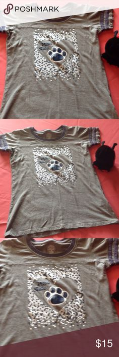 Girls size xlarge Penn State tee Girls size x large tee shirt with Penn State heart on front & Paw print in Blue. Shirt is dark gray with dark blue accents. In excellent preowned condition, no stains, rips, from a non smoking home rivalry threads Shirts & Tops Tees - Short Sleeve