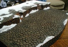 These cobblestone, brick and snow pieces are all hand carved out of styrofoam.no actual brick or rock used. No actual snow either. And these snow banks are permanant so no powdery mess around your village. Halloween Village Display, Lemax Village, Christmas Village Display, Halloween Town, Village Houses, Village People, Fairy Houses, Christmas In The City, Christmas Town