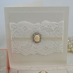 Google Image Result for http://www.imaginedoingityourself.co.uk/Images/cameo_pink_vintage_wedding_invitation_with_lace_and_cameo.jpg