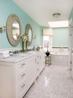 Bathroom- paint cabinets white, remove large mirror and hang individual mirrors, windown treatments
