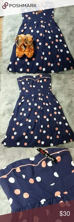 NWT FIRE Los Angeles strapless dress size XS NWT Really cute dress that could be dressed up, worn over a tshirt with vans or with some sandals...truely a dress for all occasuons. Navy base with coral and white pokadots. Measurement  12 inwaist 13 in bust 21 from waist to hem Fire Los Angeles Dresses Mini