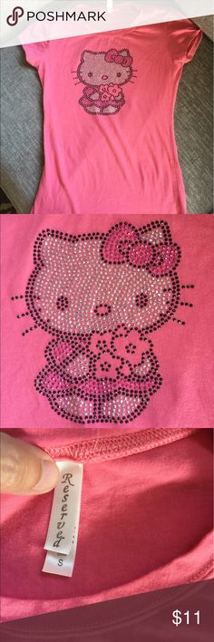 Hello Kitty 🐱 small tee A great tee if you are in love with Hello Kitty! This form fitting tee fits more like an extra small than a small. In good condition, no stones missing. Tops Tees - Short Sleeve