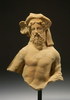 GREEK TERRACOTTA HALF-FIGURE OF DIONYSOS  As a banqueteer.  Tarentine, ca. 420 BC