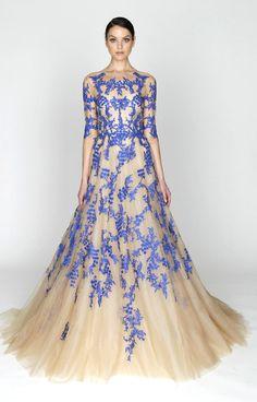 Monique Lhuillier- like an antique Blue Willow China plate.  So Rachael-Lynn Munson