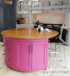 Subtle shades of grey used on most of the cabinetry contrasts beautifully with the striking pink island and oak worktop. Pink Island, Kitchen Colour Schemes, Bespoke Kitchens, Work Tops, Contemporary Style, Kitchen Design, Contrast, Color, Design Ideas