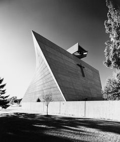 Church of St Francis de Sales by Marcel Breuer The trapezoidal-shaped front wall of the church acts as a banner or signage, with three large bells protruding over.