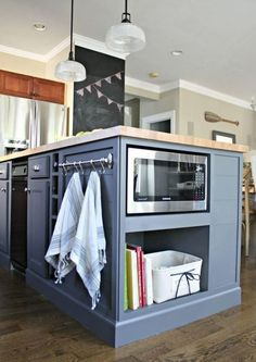 A kitchen island can be used for storage, cooking or dining. Discover these awesome kitchen island design ideas & start planning your dream kitchen. Kitchen Island With Seating Ikea, Kitchen Island With Sink And Dishwasher, Diy Kitchen Island, Kitchen Ideas, Island Microwave, Microwave Storage, Smart Kitchen, Kitchen Counters, Kitchen Designs