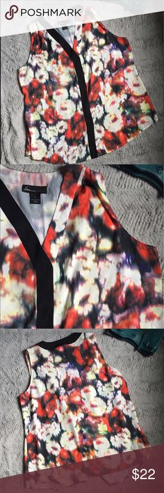Lane Bryant Floral Sleeveless shirt Refocused Floral all over print blouse. Sleeveless with black front detail, small bottom front slit under the black for a perfect fit. Lane Bryant Tops Blouses