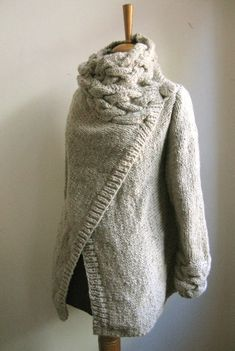 OMG. the giant braided cowl and cuffs and cross front.  I LOVE THIS.    RIONA hand knitted cardigan coat warm grey. $145.00, via Etsy.