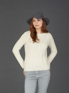 Design from The Second Sublime Natural Aran Handknit Book (687) 14 designs for women knitted in Sublime Natural Aran which is made in Yorkshire, England.  Sublime Natural Aran has an unrivalled softness and comes in a stunning palette of soft, calm neutrals and bold, modern shades. In this collection we have taken inspiration from an era that is synonymous with striking garment shapes, it has to be the swinging 60's of course! | English Yarns
