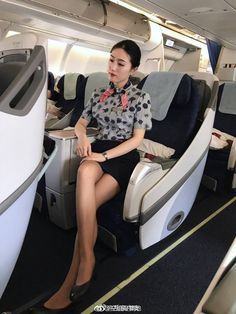 Flight Attendant taking a rest. Airline Uniforms, Maid Cosplay, Lovely Legs, Pantyhose Legs, Cabin Crew, How To Pose, Dress For Success, Virgin Atlantic, Asian Woman