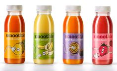 Simple plastic juice bottles, using product color to communicate the brand and beautifully designed labeling.