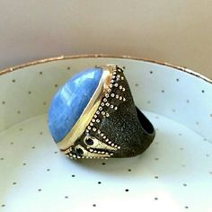 """BORA Handmade Aquamarine Sapphire Silver Gold Ring Handmade by Bora in Brooklyn. Size: 8-- 1.5"""" X 1.25"""" X 1.25"""" -- 31.71 grams. Solid 925 silver (oxidized) with 24K gold accents. Gorgeous bohemian design inspired by the Ottoman and Byzantine empires with a modern touch. Asymmetrical one-of-a-kind design built around the large aquamarine sits slightly sideways on the finger. Two little sapphires one side and a single sapphire the other. The ring is 100% authentic and in brand new condition…"""
