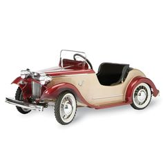 The Classic 1932 Roadster Pedal Car - Hammacher Schlemmer - This pedal car is hand built with a chain-drive system, and has pneumatic tires to ensure a more forgiving ride over bumps, while a ball joint steering mechanism provides secure handling. The upholstery and steering wheel cover are hand-stitched leatherette and faithful details include a decorative folded roof cover, a one-piece grill, working headlights, audible horn, and a hand crank parking brake.
