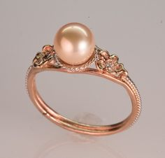 This ring is absolutely perfect. Rose gold with a pink pearl and diamond accents.