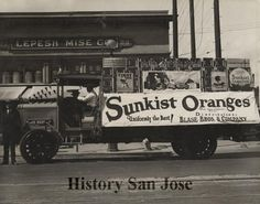 """Photo from between 1916 and 1925 of deliery truck with banner that reads """"Sunkist Oranges: Uniformly teh Best!"""" (History San Jose)"""