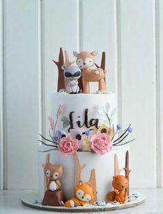 What a lovely forest animals cake! So perfect for a woodland baby shower or birthday party!