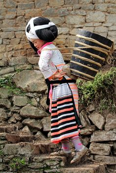 Changjiao Miao woman off to work. Guizhou, China. | © Rudi Roels, via Flickr