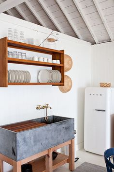 Plate rack / Steal This Look: A Scandi-Style Kitchen in a Canadian Cabin: Remodelista