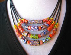 by Soleil ~ SunRiseTreasures |  Vintage Venetian African Trade beads are combined with orange jasper and black leather cord | sold