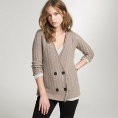 can't decide about the sweater but i really like her hair.  that's what i want mine to look like when it's long.  too bad it's too straight even to hold a wave.