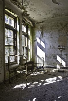 Perhaps isolation stems from the feeling of being imprisoned in one's own mind? This is a foreboding image of a derelict hospital but the sunlight streaming through the windows suggests that hope still remains. Beautiful Ruins, Beautiful Buildings, Abandoned Asylums, Abandoned Places, Old Buildings, Abandoned Buildings, Abandoned Hospital, Scary, Creepy