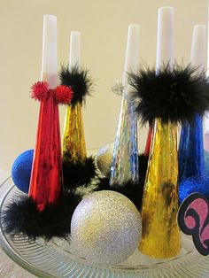 New Years Eve noisemakers make the night super fun.  http://www.centurynovelty.com/detail_201_148-021.html