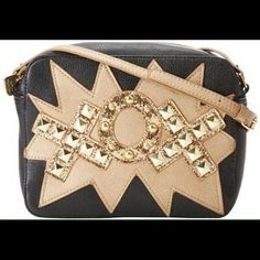"""1 HOUR SALE!!!! NWT Betsey Johnson XO Bag 1 HOUR SALE!!! NWT Betsey Johnson black & gold XO cross body bag!!!!  This bag is gorgeous!!!!  It has gold bling & gold sequins & glitter on the front!!!!  Measures 9"""" in length & 7"""" in height --strap drop 23"""" Betsey Johnson Bags Crossbody Bags"""
