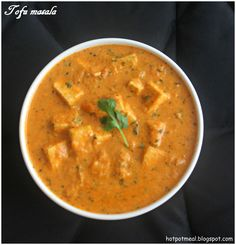 Tofu Masala  Ingredients:  Tofu - 1 packet  Almonds - 10  cashews - 6  Red chilly powder - 1 tsp  Coriander powder - 2 tsp  Turmeric powder - 1/4 tsp  Kasuri methi - 1 tsp or cilantro, chopped  Salt - as per taste   Oil - 1 tsp + 1 tsp +1 tbsp  To grind:  Onion - 2  Tomato - 2  Ginger- 1 tbsp  Garlic - 3