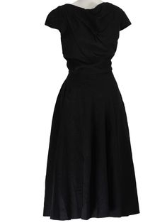 Late 40s -Home Sewn- Womens little black cotton flame stitched mid length swing dress with drop cross over pinch pleating from right shoulder to left empire waistline hem. Modest boat neckline, short cap sleeves, side metal zip closure and bias cut seaming from right hip into full skirt. Would look great with our without crinoline underskirt.