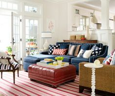 Blue couch with bold red accents