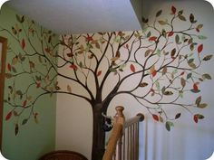 Painted tree, starched fabric leaves.  Removable - for crazy people to replace the leaves with seasonally appropriate colors.