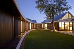 The Subiaco Oval Courtyard by Luigi Rosselli Architects, a cluster of interconnected pavilions with an oval courtyard garden at their centre.