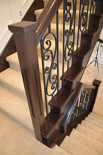 A simple routered newel post on a staircase landing. | Flickr