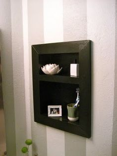 Rip out an old medicine cabinet and replace it with a shelf.