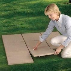 Outdoor Flooring Pavers          They are purchased in packages of 12 and each tile is 16 inches square.  They are constructed of lightweight polypropylene, but look like authentic stone pavers.  They have spikes on the bottom that grip anywhere there is raw ground, gravel or grass to hold them in place.