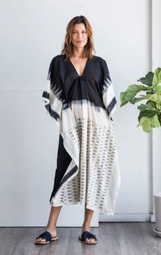 Ikat hand-loomed, sari caftan in medium weight cotton with black body, white bottom and border detail. Handcrafted using homegrown Indian saris, TWO caftans fal