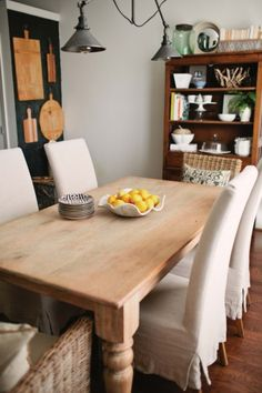 Gorgeous dining room and home tour of Two Ellie - love the way she displays her cutting boards! eclecticallyvintage.com