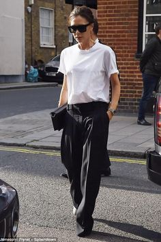 Victoria Beckham wearing Victoria Beckham D-Frame Acetate Sunglasses and Victoria Beckham Pleat Pants