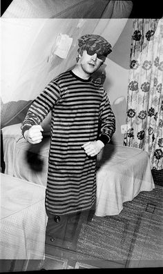 While in Toronto during the 1964 North American tour, a fan sent John some red and black striped pajamas. They are pretty silly looking, so for a laugh John put them on for a photo.
