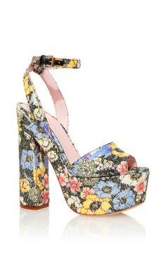 These **Giamba** platform heels are crafted in a sequined floral print and features a platform, block heel and ankle strap closure.