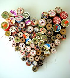 How cute is this...vintage spools of thread made into a heart shape.