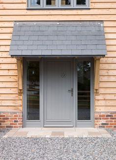 Foxwhelp Barn - Border Oak - oak framed houses, oak framed garages and structures. Front Door Canopy, Front Door Porch, Front Porch Design, House Front Door, House With Porch, Oak Front Door, Barn Door Garage, Door Overhang, Border Oak