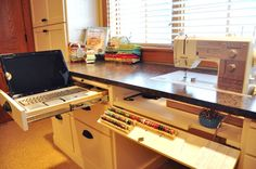 Sewing Room Ideas, Continued | Trends and Traditions (I like the pull-out section/drawer for the laptop!)