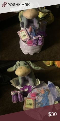 Talking flapping ears  diaper cake Talking flapping ears eyyore stuff animal Receiving blanket Eyyore onesie Teether Bottle Pacifier  Eeyore happy birthday book Purple bootie socks Diapers will be wrap in plastic with ribbon Disney Other