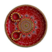 Now, change your way of worship with this diwali hand painted pooja thali with dazzling look and will definitely appear more sparkling after placing diyas. This thali is made of brass and it's a complete handmade item decorated with green kundan and sorrounded by mirror making it more alluring. You can also present this thali as a gift specially on diwali occasion or any other fest.  This Diwali special combo set offer you 1 Decorated Pooja Thali and 2 Diya.