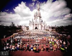 "Happy 40th, Walt Disney World.  The entire Walt Disney World staff stands in front of Cinderella's Castle prior to the grand opening of the amusement park. The largest and most visited amusement park in the world, Walt Disney World opened on Oct. 1, 1971. It is the largest single-site employer in the U.S., and employs more than 66,000 ""cast members.""  see more — Walt Disney: The Man and His World"