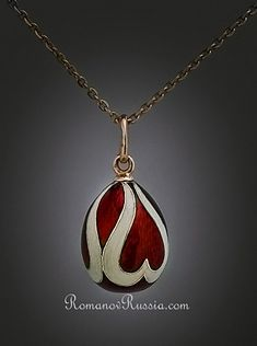 Faberge gold mounted two-color guilloche enamel egg pendant     made in St. Petersburg between 1899 and 1904 by workmaster Alfred Thielemann.