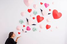 How fun is this origami wall display?! Save this DIY to make a fun photo backdrop for your Galentine's Day party.